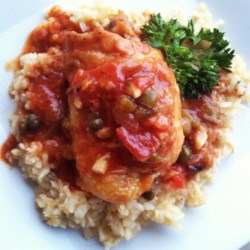 Ellen's Chicken Cacciatore Recipe - Tender chicken thigh meat simmers in a savory tomato sauce for an Italian-inspired meal that's ready in just over an hour but tastes like it cooked for hours.