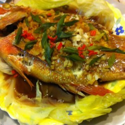 Chinese-Style Steamed Fish Recipe - Easy to prepare, hard to mess up, and very versatile - this steamed fish dish is seasoned with fresh ginger, garlic, and soy sauce.