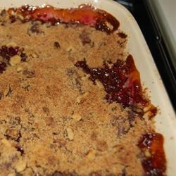 Cherry Crumble Recipe - Sweet, sweet cherries are sandwiched between layers of a sweet rolled-oat crumb mixture. This crumble is especially wonderful when served warm with whipped cream flavored with cinnamon.