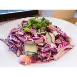 Appalachian Slaw Recipe - Chopped cabbage, tomato, cucumber and onion all mingle with a seasoned mayonnaise dressing in this crunchy salad.