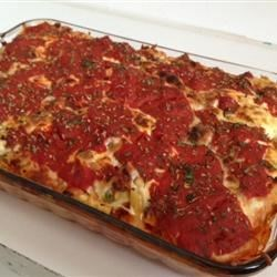 Best Ziti Ever with Sausage Recipe - Ziti is layered with sausage, ricotta, mozzarella and tomato sauce, then baked until bubbling.