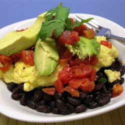 Black Bean Breakfast Bowl Recipe - This quick and easy breakfast is loaded with protein and flavor from layers of black beans, scrambled eggs, avocado, and salsa.