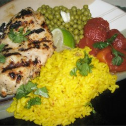 Montana Grilled Chicken Recipe - Lemon and garlic combine with a light Italian salad dressing for a mouth-watering  grilled chicken.