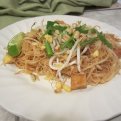 Authentic Pad Thai Noodles Recipe - Make your own pad Thai recipe at home using this simple vegetarian recipe of rice noodles cooked with scrambled egg and tofu and topped with a perfectly-balanced sauce.