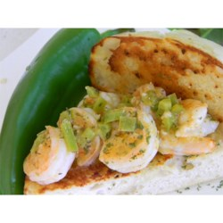 Saba's Shrimp Sandwiches Recipe - Shrimp pan-fried with mild chile peppers, garlic, and lemon juice are piled on toasted French bread, and garnished with cilantro. A simple, satisfying shrimp sandwich.