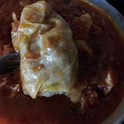 "Sweet and Sour Stuffed Cabbage Recipe - These cabbage rolls are stuffed with a filling of ground beef, rice, and raisins. The stuffing gets an extra tang from citric acid, or ""Jewish sour salt."""