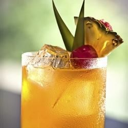 Mai Tai Recipe and Video - Two flavors of rum combine with pineapple juice and orange juice to make a yummy, fruity drink.