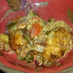 Eggplant and Zucchini Casserole Recipe - This yummy casserole has great flavors and texture. Eggplant and zucchini are layered with stuffing and lots and lots of Colby cheese. The casserole comes out of the oven smelling and tasting wonderful.