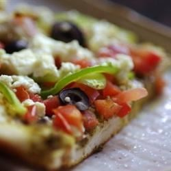 Pesto Pizza Recipe - Top a prepared pizza crust with pesto, your favorite veggies and feta cheese and you've got a great, quick and easy meal.