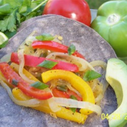 Veggie Fajitas Recipe - My family loves these peppery veggie fajitas! Serve the fajitas with flour tortillas, cheddar cheese, lettuce, tomatoes, sour cream, and I even put steamed broccoli on the side (so each can add broccoli if wanted).