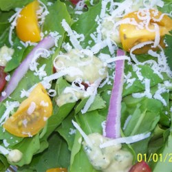 Arugula Salad with Avocado Citrus Vinaigrette Recipe - Here's a beautiful salad for that winter-into-spring season when the baby arugula leaves are so tender. A homemade avocado-citrus vinaigrette tops this flavorful salad, which contains Greek-style olives and shaved Parmesan cheese.