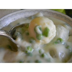 Creamed Peas and Onions Recipe - In this classic accompaniment to a holiday meal, frozen peas and pearl onions are stirred into a basic white sauce.