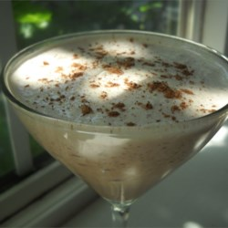 Summertime Wonder Recipe - Coffee flavored liqueur is blended with milk, ice and just a touch of coconut extract in this summer drink.