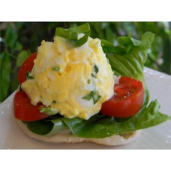 Tomato Basil Egg Salad Sandwich Recipe - The classic pairing of tomatoes and basil brings a gourmet flair to this easy-to-make egg salad sandwich.
