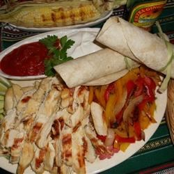 Marinated Fajita Chicken Recipe - Chicken marinated in lime juice, chili powder, red pepper flakes, garlic, and cumin makes for great fajita meat.