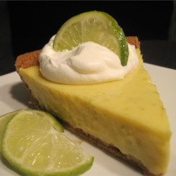 Easy Key Lime Pie I Recipe - To make this tart and creamy blue ribbon pie, egg yolks, lime juice and condensed milk are stirred together, poured into a graham cracker crust, and baked.
