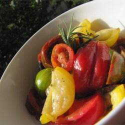 Heirloom Tomato Salad with Rosemary Recipe - Fresh and colorful heirloom tomatoes need only a few additions to make a light and refreshing salad.