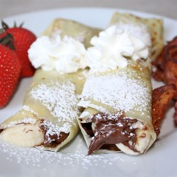 Chocolate Hazelnut Fruit Crepes Recipe - Can you say yum!!! I had these at a French breakfast restaurant, this recipe is the closest I can get it. Its so quick and easy but looks and taste like a gourmet breakfast! You can use any fruit you would like - strawberries, kiwi, pineapple are all great too !!