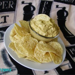Fiesta Guacamole Recipe - This spicy guacamole combines hot salsa, chili powder, and hot pepper sauce with avocados and mayonnaise for a crowd-pleasing dip.