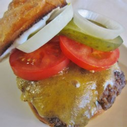 Bronco Burger Recipe - Roasted jalapenos, onion and a few secret ingredients make these burgers spicy and irresistible. The manly man burger (not for wimps), great for NFL tailgating.