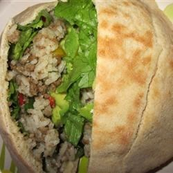 Beefy Rice Salad Sandwiches Recipe - Pita pockets stuffed with ground beef and rice with fresh lettuce and tomatoes dressed in oil and vinegar.