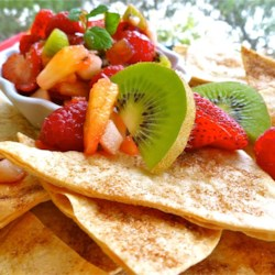 Annie's Fruit Salsa and Cinnamon Chips Recipe and Video - This delicious salsa made with fresh kiwis, apples and berries is a sweet, succulent treat when served on homemade cinnamon tortilla chips. Enjoy it as a summer appetizer or an easy dessert.