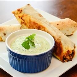 Southwestern Egg Rolls Recipe and Video - An assortment of traditional Southwestern-style ingredients are wrapped inside small flour tortillas and deep fried.