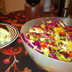 Confetti Coleslaw Recipe - Red and green cabbage is tossed with carrots, green onion and red bell pepper in a sweet and tangy cider vinaigrette.