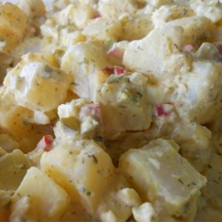 Crystal's Awesome Potato Salad Recipe - Three peppers--roasted red pepper, red pepper flakes and pepperoncini--add color, flavor and heat to a classic potato salad.