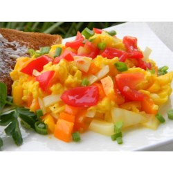 Scrambled Eggs a la Charlotte Recipe - Tarragon adds a distinctive flavor to this veggie-loaded egg dish.