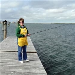 Fishing off the dock on the bay, in my apron!