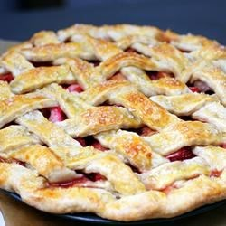 Renee's Strawberry Rhubarb Pie Recipe - Loads of fresh rhubarb, strawberries, and cinnamon make a pie filling for a baked latticed pie. Raw sugar crystals add sparkle to the pretty woven crust.