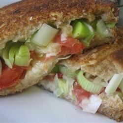 Cheddar, Baby Leek and Tomato Sandwich Recipe - Grilled cheddar sandwiches with leek and tomato make for a wonderful lunch!