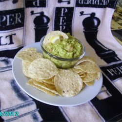 Guacamole 'n Cheese Recipe - This guacamole dip has an added twist of Cheddar cheese. It will be the hit at your next potluck or party!