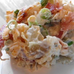Kristen's Bacon Ranch Potato Salad Recipe - This tasty ranch-flavored potato salad is just calling for you to make it your own. It's full of savory bacon, Cheddar cheese, and green onions.  Add some heat with hot pepper sauce, or stir in some of your favorite crunchy veggies. It's sure to be a hit!