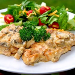 Perfect Chicken Recipe - Chicken thighs are pan-fried to a golden crust and baked in a creamy mushroom and wine sauce flavored with lemon and capers.