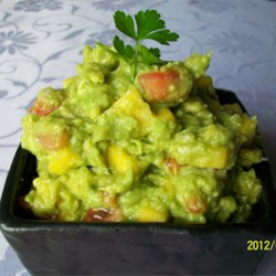 Savory Mango Guacamole Recipe - This mango guacamole puts a twist on the traditional ingredients for a sweet and savory flavor. Enjoy with chips!