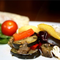 Ratatouille with Polenta Rounds Recipe - Ratatouille made with eggplant, zucchini, and lots of herbs is baked under layers of prepared polenta slices and fresh mozzarella cheese for a hearty main dish. It looks fancy enough for company but it's easy to make with prepared polenta.