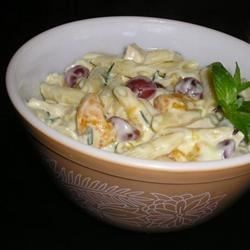 Lemon Mint Pasta Salad Recipe - Pasta, green onions and grapes are dressed up with a lemony yogurt sauce to make a great summer salad, perfect for if you have mint growing in your garden.