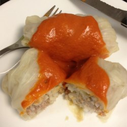 Stuffed Cabbage/Golabki Recipe - Pork, onion, rice and seasonings are tucked inside these bundles of cabbage simmered in a mushroom broth. Then they are topped with a tomatoey sauce. These are especially delicious served with potatoes.