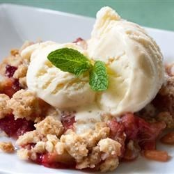 Rhubarb Strawberry Crunch Recipe - Slices of strawberry and rhubarb are topped with a buttery, brown sugar and oat crumble then baked until golden brown and crunchy.