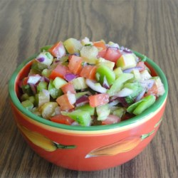 Tangy Rhubarb Salsa Recipe - Take advantage of spring's abundance of fresh rhubarb with this slightly spicy and colorful rhubarb salsa! Best made with thin stalks of rhubarb.
