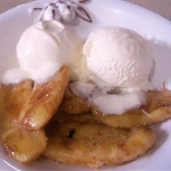 Bellyful of Barbecued Bananas Recipe - Bananas rolled in brown sugar and cinnamon are grilled until caramelized and served with vanilla ice cream. You can also cook them in a skillet with melted butter.