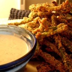 Green Bean Fries Recipe - These are tasty alternatives to both regular french fries and also a way to get in your veggies! I make them by the truckload and freeze them. My husband hates green beans but gobbles these up! Serve with Ranch dressing or another favorite dipping sauce.
