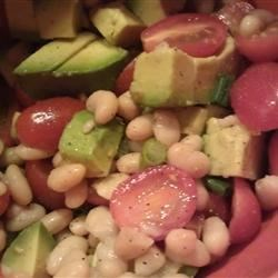 White Bean, Tomato, and Avocado Salad Recipe - Cannellini beans, avocado, and grape tomatoes are tossed with lemon juice and olive oil in this simple and tasty salad.