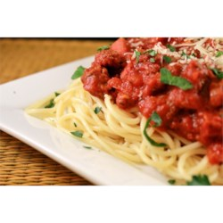Mama Palomba's Spaghetti Sauce Recipe - This Italian-inspired tomato sauce is filled with Italian sausage, ground chuck, and the right amount of herbs and spices. It is simmered on the stove for hours, for a flavorful and rich topping for your pasta.