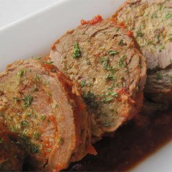 Bob's Slow Cooker Braciole Recipe - Your slow cooker provides the perfect low and slow heat to braise this traditional Italian rolled flank steak. Jarred marinara sauce makes it a quick fix too.
