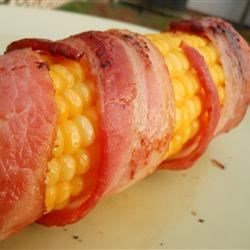 Corn with Bacon and Chili Powder Recipe - Ears of corn wrapped in smoky bacon and seasoned with chili powder before grilling.