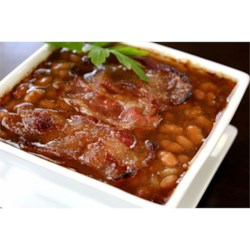 Cola Beans Recipe - This slow cooker recipe is a favorite at potlucks and barbeques. I've often wondered if I get invited for my company or my Cola Beans! This recipe can also be made in the oven.