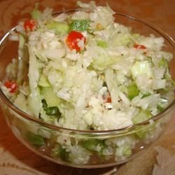 Sweet 'n' Sour Slaw Recipe - This snappy cabbage slaw has a sweet, tangy dressing flavored with mustard and celery seeds.